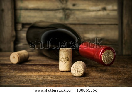 bottle of red wine with corks - stock photo