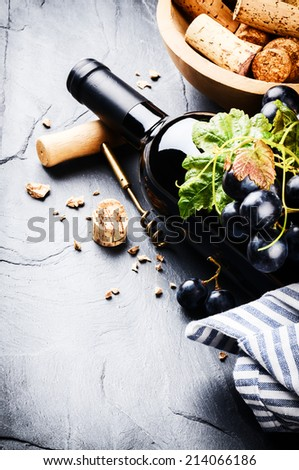 Bottle of red wine with fresh grape  - stock photo