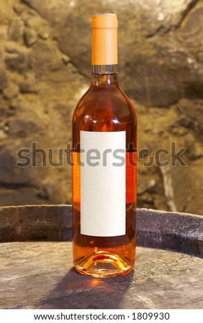 bottle of rose wine with a blank label - stock photo