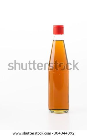 bottle of sesame oil on white background - stock photo