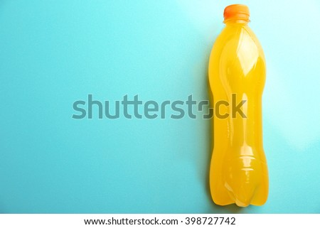 Bottle of soft drink on the blue background, top view - stock photo