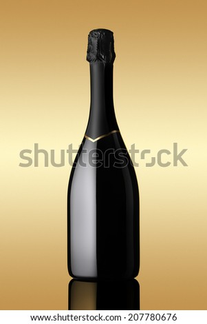 bottle of sparkling wine on gold background - stock photo