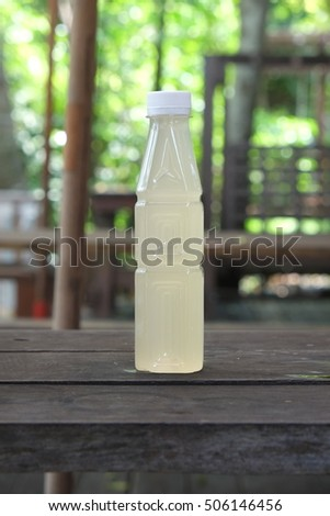 Bottle of sweet juice in the cafe, natural sweet, sugarcane , coconut juice , coconut sugar