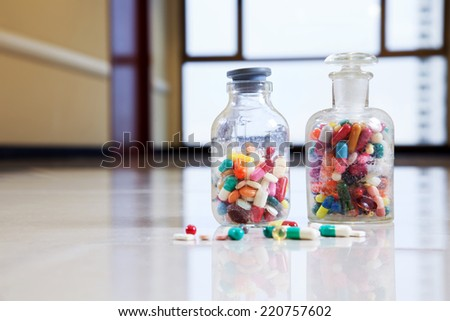 Bottle of tablets, capsules and medical drug - stock photo