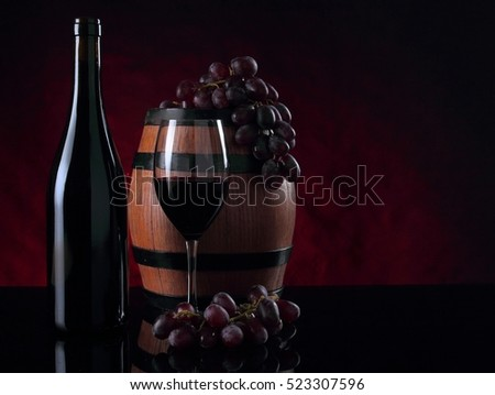 Bottle of vine, barrel, vineglass and grapes