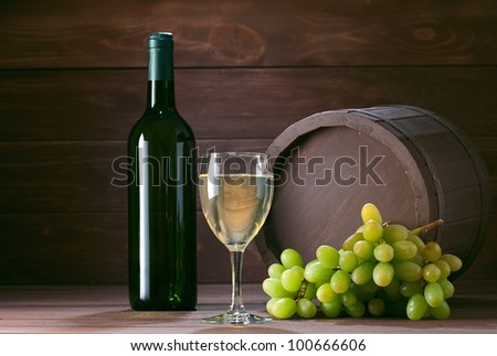 bottle of vine on  wooden background - stock photo