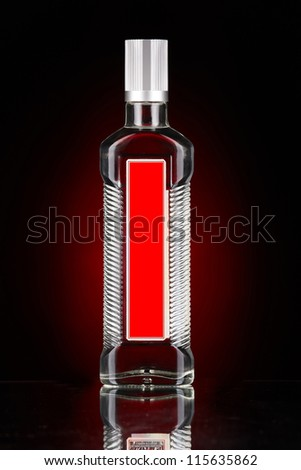 Bottle of vodka isolated on red