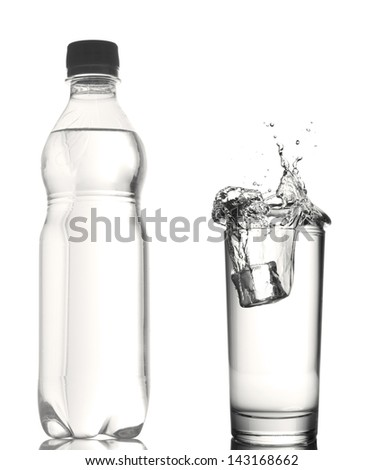 bottle of water and glass with water splash - stock photo