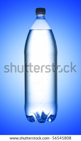 Bottle of water on blue background, studio shot. With path - stock photo