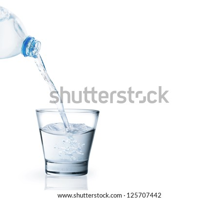 Bottle of water with a glass isolated on white - stock photo