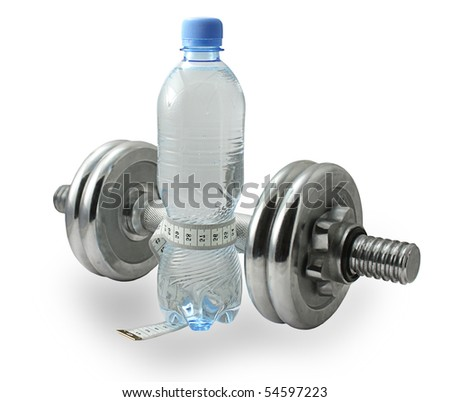 Bottle of water with a measuring tape around it and dumbbell - stock photo