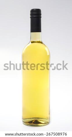 Bottle of white wine on a white background. - stock photo