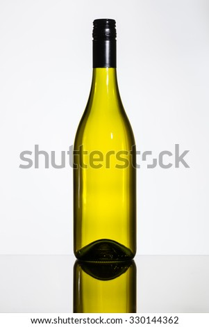 bottle of white wine on glass table and white background