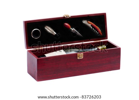 bottle of wine in box with accessories - stock photo