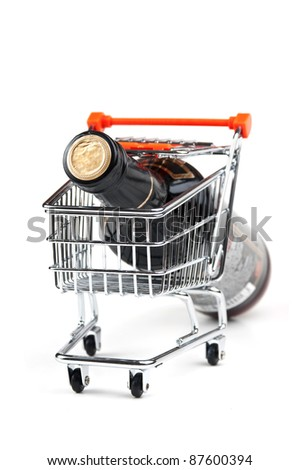 bottle of Wine in shopping cart  isolated on white background - stock photo