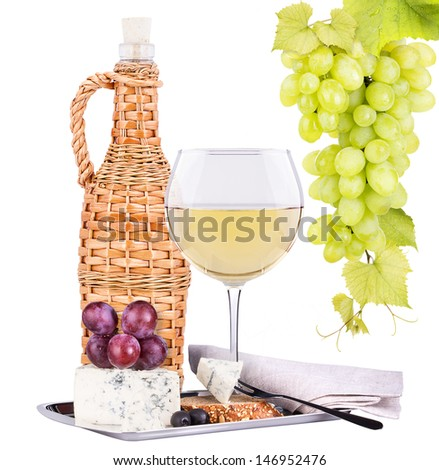 bottle of wine with glass, assortment of  cheese and grapes isolated on white