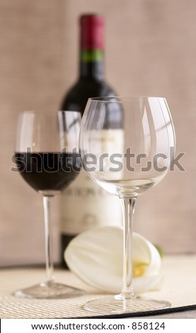 Bottle of wine with two glasses and flower - stock photo