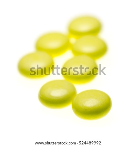 bottle of yellow medical valerian pills on a white background, herb medicine