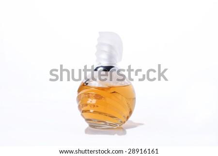 Bottle of yellow perfume. Isolated object on white background - stock photo