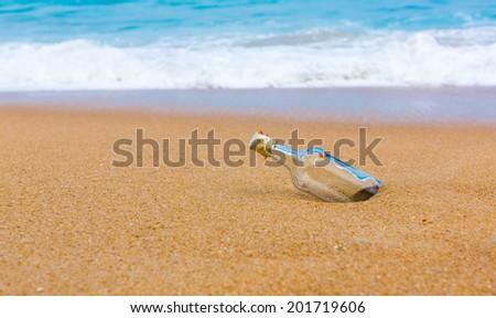 Bottle on a beach - stock photo