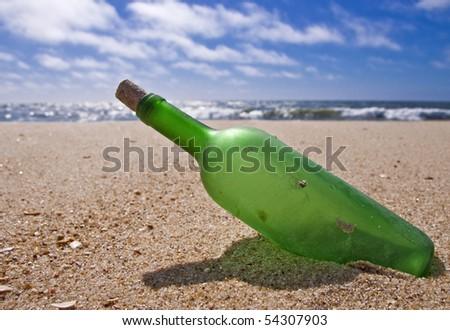 bottle on the beach, garbage - stock photo