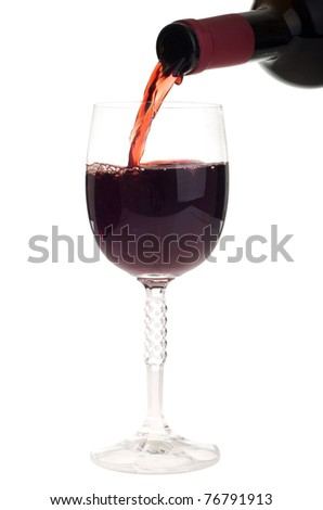 bottle pouring red wine into a crystal glass (isolated on white background) - stock photo