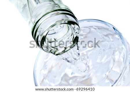 bottle pouring water into  glass - stock photo