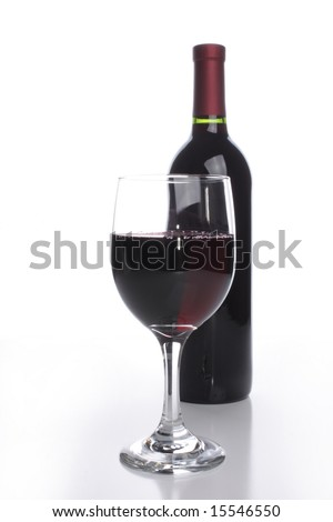 Bottle with a glass of red wine - stock photo