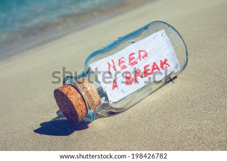 "Bottle with a message ""need a break"". Stress and vacation concept."