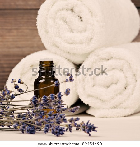 Bottle with aroma oil. Spa theme - stock photo