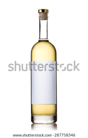 Bottle with golden liquor - stock photo