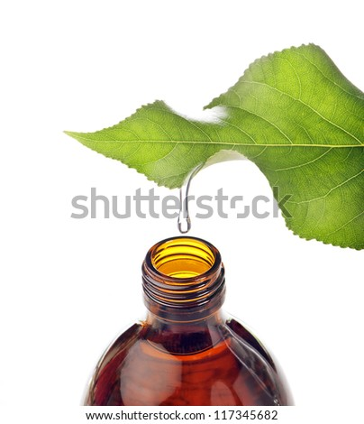 bottle with homeopathy balm and leaf