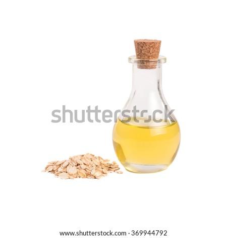 Bottle with oats oil , Oat (Avena sativa) - stock photo