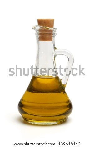 Bottle with olive oil isolated on white background. Close-up. - stock photo