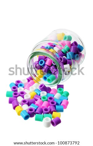 Bottle with Plastic Beads on White Background