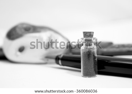 Bottle with poison, pen and mask on white. Concept of suicide or murder.