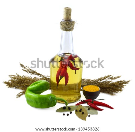 Bottle with red hot chili peppers and spices - stock photo