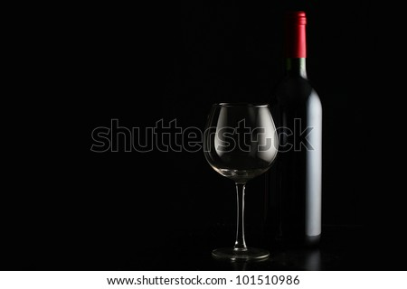 bottle with red wine and glass - stock photo