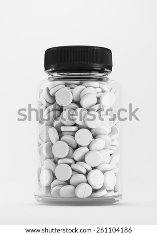 Bottle with round pills isolated on white. - stock photo