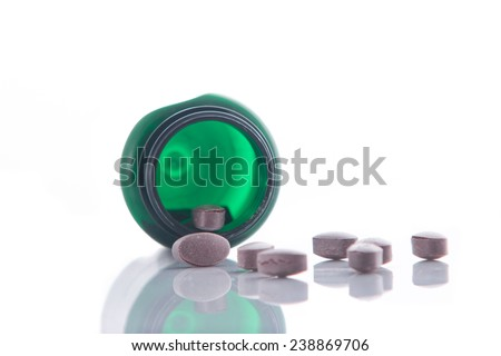 Bottle with vitamin pills isolated on a white background - stock photo