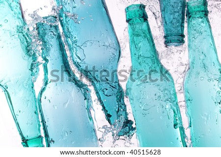 Bottle with water. Creative splashing water - stock photo