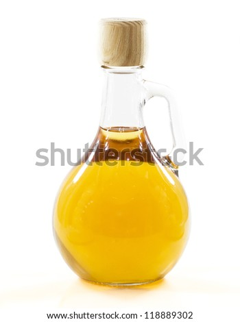 bottle with yellow liquid in a white background - stock photo