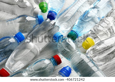 Bottled water on the wooden table,top view - stock photo