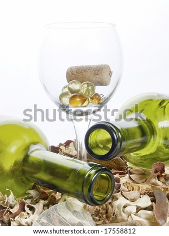 Bottles and a wine glass for wine