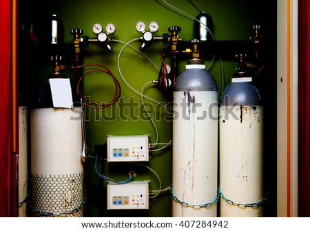 Bottles and controls of a high pressure gas station for medical gases. - stock photo