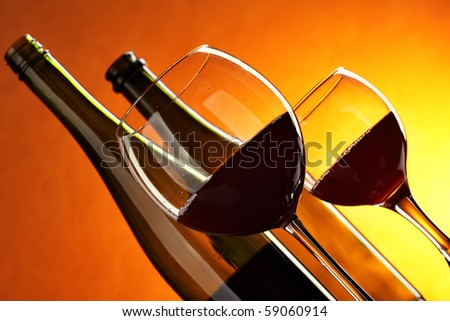 Bottles and glasses of red wine close-up - stock photo