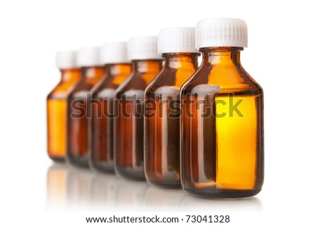 Bottles glass with a medicine, isolated on white - stock photo