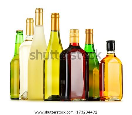 Bottles of assorted alcoholic beverages isolated on white background - stock photo