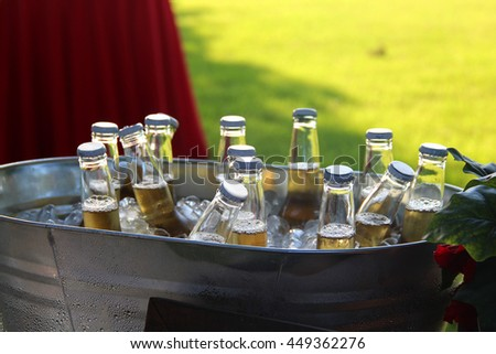 Bottles of beer in an ice bucket, ready to drink on a hot summer day - stock photo