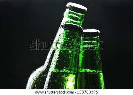 Bottles of beer on black background - stock photo